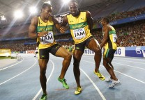 Nesta Carter, Yohan Blake and Usain Bolt of Jamaica celebrate winning their men's 4x100 metres relay final at the IAAF World Athletics Championships in Daegu