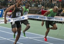 Asafa Powell crosses the finish line of the 50 meter dash to win in New York