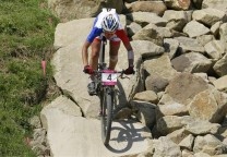 France's Julie Bresset competes to win gold during the women's Cross-country mountain bike cycling event at Hadleigh Farm during the London 2012 Olympic Games